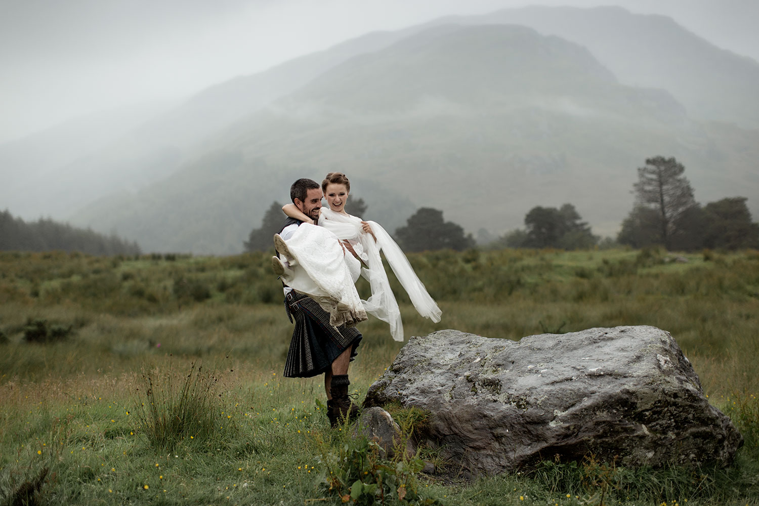 groom lifts bride at MONACHYLE MHOR
