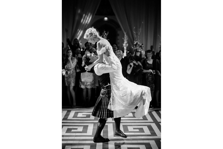 Groom lifts bride at Traquair House in Edinburgh