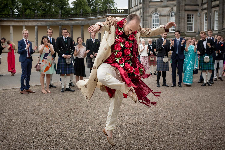 groom dances at hindi wedding