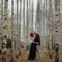 Kissing couple amongst Birch trees