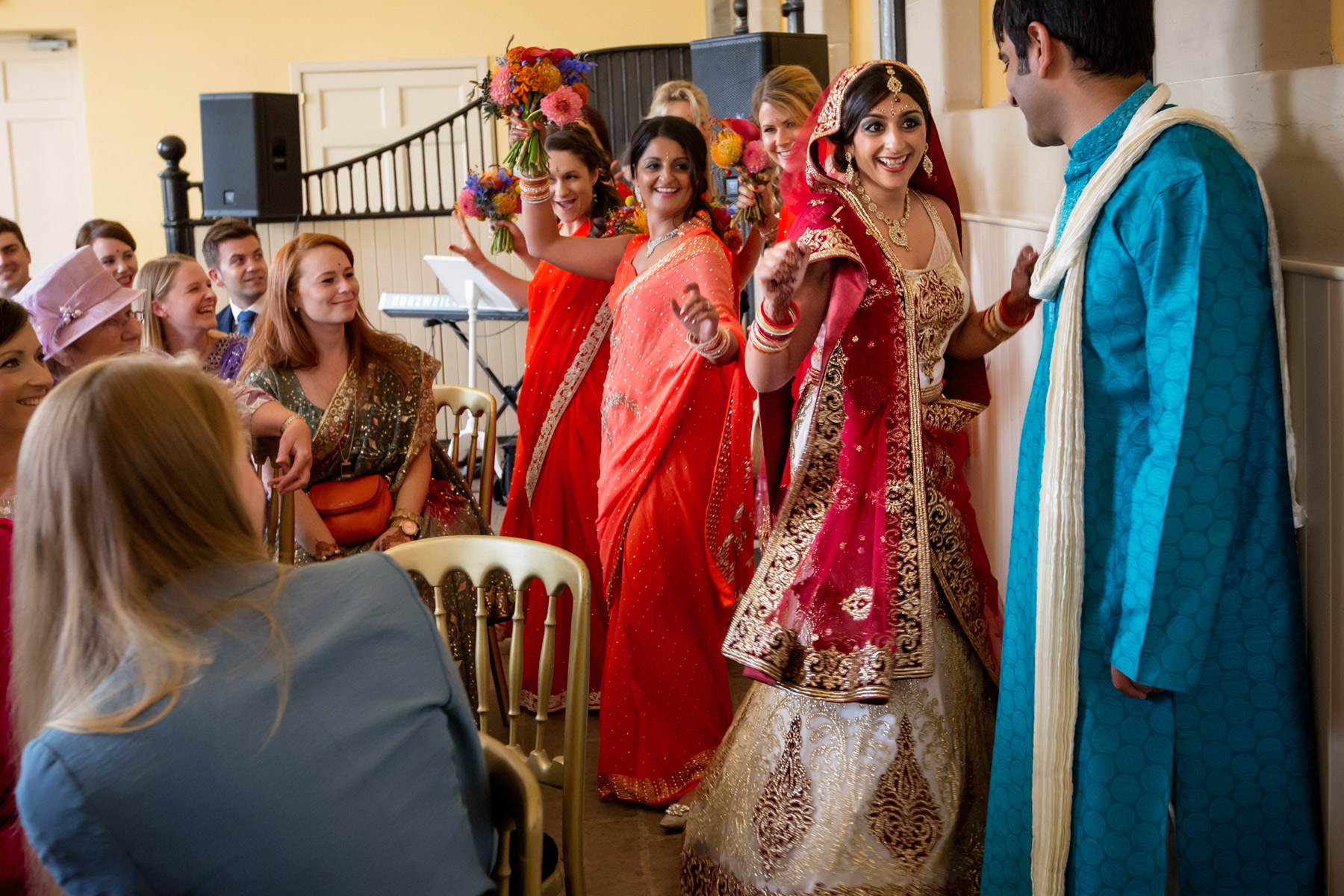 bride arrives at Bollywood wedding in scotland