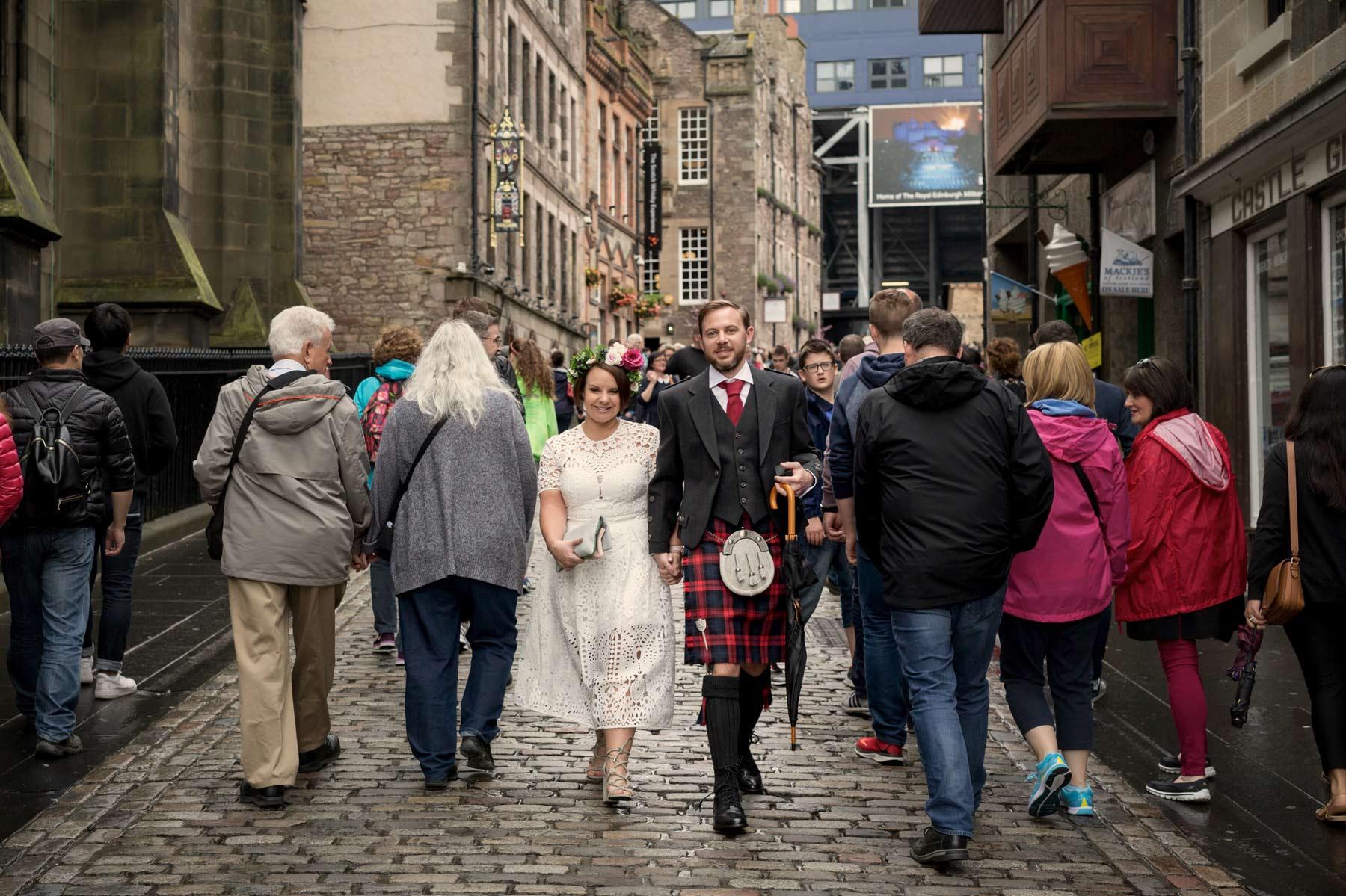 Bride, groom, kilt, walking, Castle Hill, Edinburgh, old town, wedding